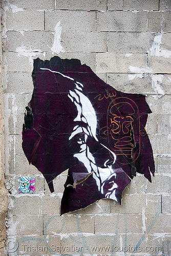 stencil graffiti poster on cinder blocks wall (paris), concrete, street art, stock photo