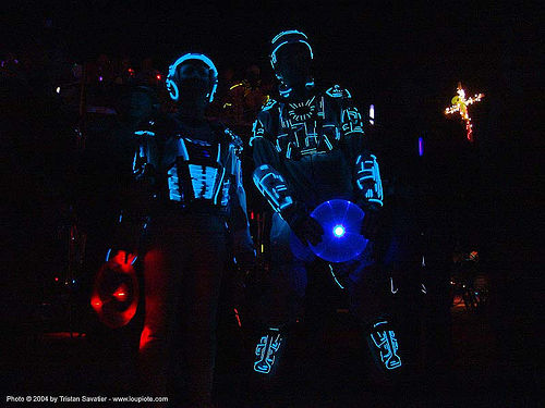 steph & gadget in their EL-wire tron costumes - burning man 2004, burning man, el-wire, electroluminescent wire, gadget, glowing, night, steph, tron