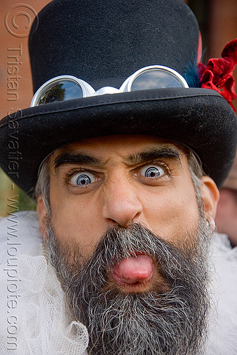 steven raspa - burning man decompression 2009 (san francisco), beard, burning man decompression, color contact lenses, contacts, goggles, hat, special effects contact lenses, steven raspa, sticking out tongue, sticking tongue out, theatrical contact lenses