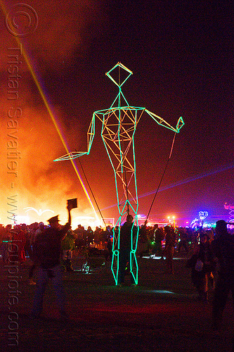 stick figure walking - burning man 2012, art installation, burning man, costume, glowing, night, the man, unidentified art, walking