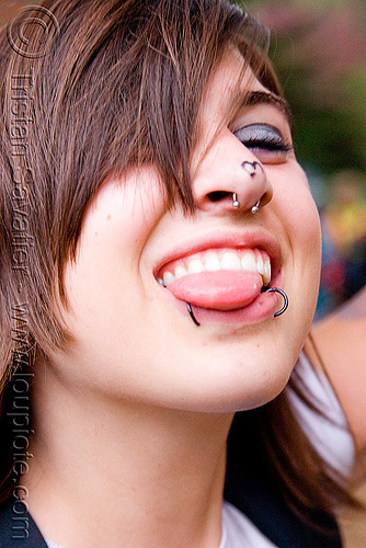 sticking tongue out - snake bite lip piercing, golden gate park, jess, nose piercing, party, people, raver, septum piercing, snake bites piercing, sticking out tongue, woman