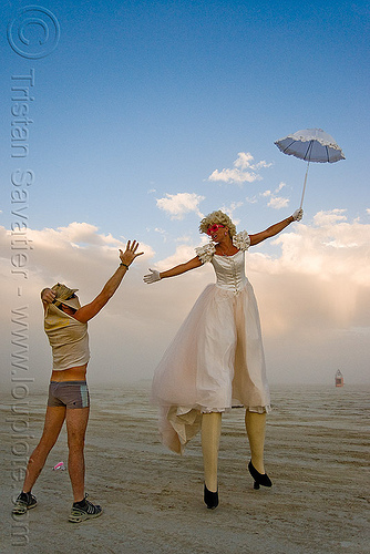 stilts performer - jesster - burning man 2009, burning man, circus metropolus, jessica, jesster, stilts, stiltwalker, stiltwalking, umbrella