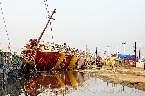 storm damage & flood - bamboo structure toppled by the wind - kumbh mela 2013 (india), ashram, bamboo structure, broken, collapsed, destruction, flood, flooded, gate, hindu, hinduism, infrastructure, kumbha mela, maha kumbh mela, street, water