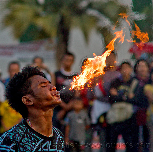 street circus performer breathing fire (jakarta), crowd, eid ul-fitr, fatahillah square, fire breather, fire breathing, fire performer, indonesia, jakarta, spectators, spitting fire, street performer, taman fatahillah