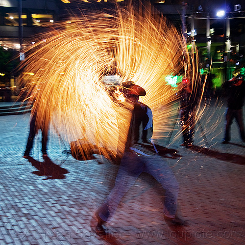 street performer with fire whip (san francisco), cary, cowboy hat, fire dancer, fire dancing, fire performer, fire spinning, fire whip, man, night, spinning fire