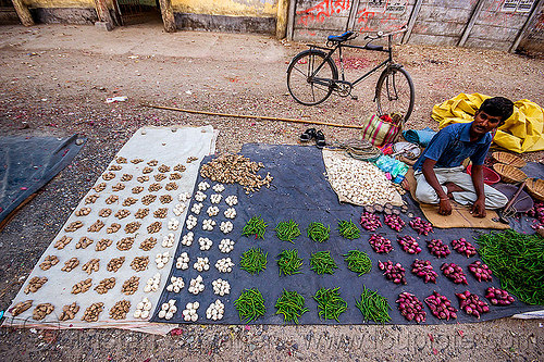 street vendor stall - ginger - garlic, hot chili peppers - shallots (india), bicycle, chili pepper, farmers market, gairkata, ginger, india, man, produce, shallots, sitting, stall, street market, street seller, vegetables, veggies, vendor, west bengal