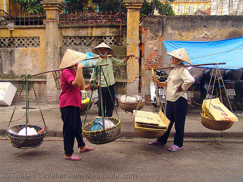 street vendors carrying twin baskets suspended from shoulder poles - vietnam, hanoi, shoulder pole, street market, twin baskets