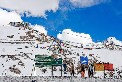summit - khardungla pass - ladakh (india), buddhism, khardung la pass, ladakh, mountain pass, mountains, prayer flags, signs, snow, tibetan