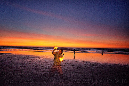 sunset fire dancing on ocean beach, dog, fire dancer, fire dancing, fire performer, fire poi, fire spinning, flame, man, nicky evers, night, ocean beach, sea, spinning fire, sunset