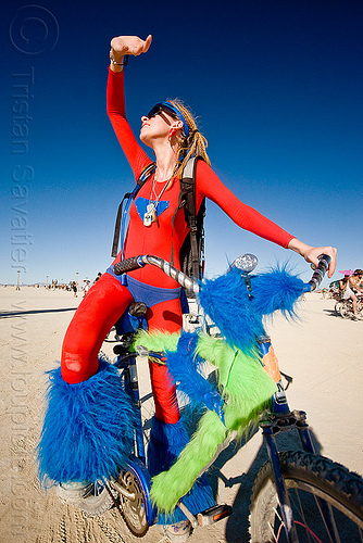 superwoman fuzzy costume, bicycle, bike, blue, burning man, costume, fluffy, fuzzy, good girl, green, katie, plushy, red, super girl, super hero, superwoman, woman