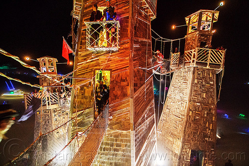 suspension bridges between the towers of the lighthouse - burning man 2016, art installation, black rock lighthouse, burning man, light house, night, suspension bridges, walking bridges