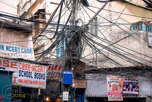 tangled electrical wiring in street - delhi (india), delhi, electric, electricity, infrastructure, pole, street, tangled, wires, wiring