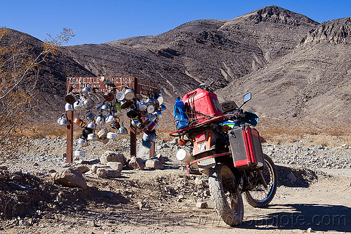 teakettle junction on the road to the racetrack (death valley), death valley, dirt road, dual-sport, fuel, gas can, gasoline, jerrycan, kawasaki, klr 650, motorcycle touring, mountains, pannier case, petrol, plastic can, rack, road sign, teakettle junction, teakettles, unpaved