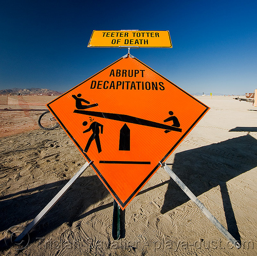 teeter totter of death - abrupt decapitations - burning man 2008, abrupt, beheaded, beheading, burning man, decapitations, safety sign, seesaw, stick figures, teeter totter of death, teeter-totter, trick nichols, ttod