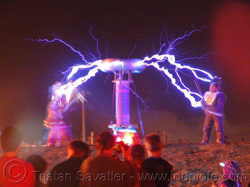 tesla coil discharge sends electric arcs, danger, dr megavolt, electric arc, electric discharge, fire art, high voltage, lightnings, plasma filaments, static electricity, tesla coil