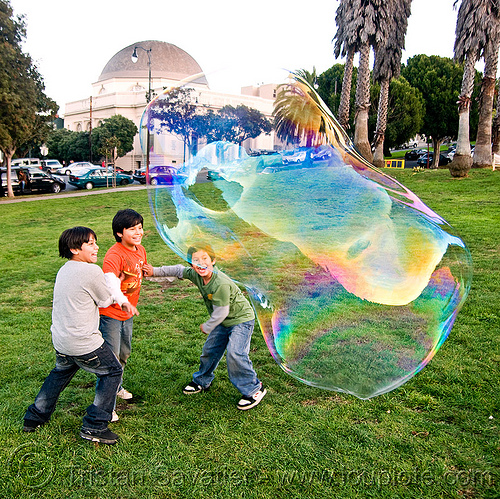 three kids and a giant soap bubble, big bubble, children, dolores park, giant bubble, iridescent, kids, playing, soap bubbles, turf