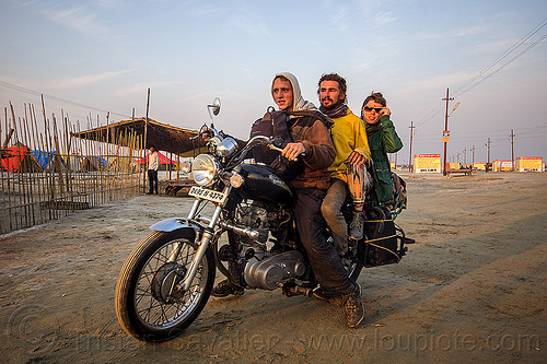three people riding a royal enfield bullet motorbike, 350cc, bun bun, hindu pilgrimage, hinduism, india, maha kumbh mela, men, motorcycle touring, motorcyclist, rider, riding, royal enfield bullet, thunderbird, wojtek, woman