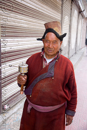 tibetan monk spinning prayer wheel, hat, ladakh, leh, man, monk, prayer mill, prayer wheel, tibetan