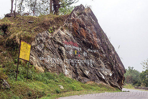 tibetan writing painted on cliff - sikkim (india), road sign, rock, sikkim, tibetan
