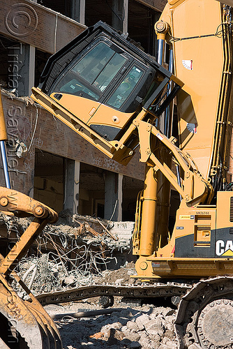 tiltable cab - caterpillar CAT 385C ultra high demolition excavator - building demolition, abandoned building, at work, caterpillar excavator, heavy equipment, high reach demolition, hydraulic, long reach demolition, machinery, presidio hospital, working