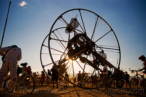 the time cycle - sunset - burning man 2009, art car, backlight, burning man, ferris wheel, homer wells, time cycle, wheels