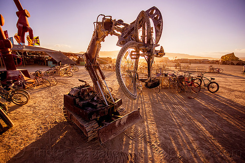 tracked hydraulic robot crushing bicycle - subjugator - burning man 2015, art, bicycle, christian ristow, grapple attachment, hydraulic arm, hydraulic grapple, machine, machinery, mechanical, robot, shadows, subjugator