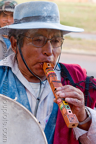 traditional andean flute, abra pampa, carnaval, carnival, folklore, gaucho, hat, man, music, noroeste argentino, old, quebrada de humahuaca, stock photo