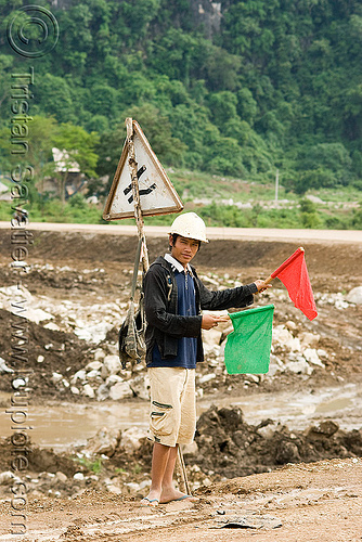 traffic semaphore - low-tech traffic control (laos), flags, laos, red, roadwork, traffic control, traffic semaphore