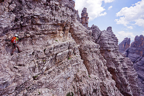 trail on ledge - monte paterno via ferrata, alps, cliff, climber, climbing harness, climbing helmet, dolomites, monte paterno, mountain climbing, mountaineer, mountaineering, mountains, parco naturale dolomiti di sesto, rock climbing, trail, vertical, via ferrata, woman