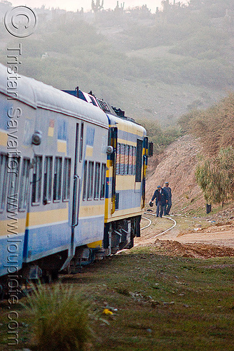 train stopped and operators checks funky looking rails ahead (bolivia), altiplano, control, deformed, enfe, examination, expreso del sur, fca, pampa, railroad tracks, rails, railway tracks, stopped, train