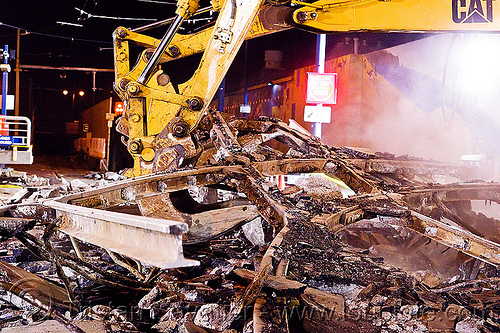 train track demolition, at work, bucket attachment, caterpillar, demolition, excavator bucket, heavy equipment, light rail, machinery, muni, night, ntk, railroad construction, railroad tracks, rails, railway tracks, san francisco municipal railway, track maintenance, track work, working
