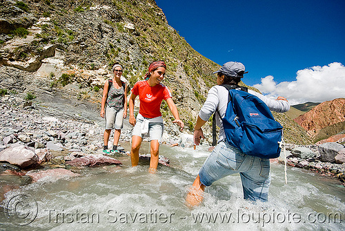 trekking - crossing river, argentina, fording, hiking, iruya, jimena, mountains, noroeste argentino, pilar, quebrada de humahuaca, river bed, river crossing, san isidro, trail, trekking, wading, wet, women