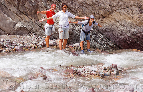 trekking - crossing a small stream, fording, iruya, jimena, noroeste argentino, pilar, quebrada de humahuaca, river bed, river crossing, san isidro, three, trail, trekking, water, wet, women