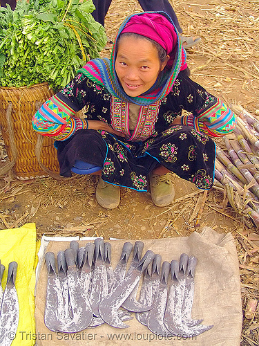 tribe woman selling billhooks at the market - vietnam, asian woman, billhooks, flower h'mong tribe, flower hmong, hill tribes, indigenous, mèo vạc, sickle, vietnam