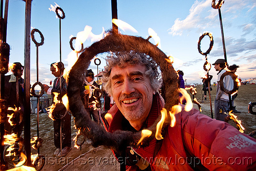tristan savatier - selfportrait - burning man 2010, dusk, fire, flames, man, rings, sculpture, self portrait, selfie, tristan savatier