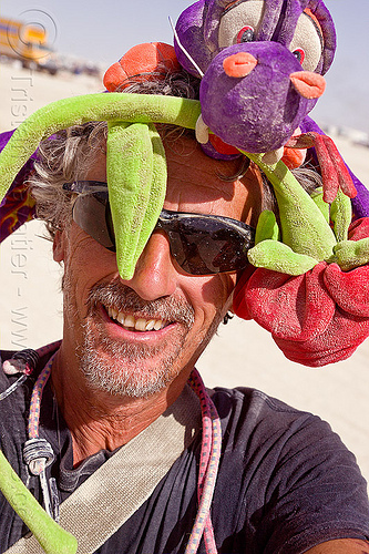 tristan savatier with burning man hat - self-portrait, bunjees, dragon, hat, headdress, man, rose, self-portrait, selfie, stuffed animal, sunglasses, tristan savatier