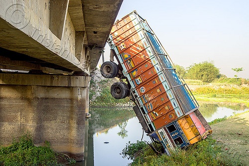 truck hanging off bridge - traffic accident (india), bridge, crash, crushed, hanging, lorry, overpass, river, road, tata motors, traffic accident, truck accident, water, west bengal, wreck