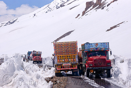 trucks passing each other on narrow mountain road - manali to leh highway (india), baralacha pass, baralachala, ladakh, mountain pass, mountains, road, snow, trucks