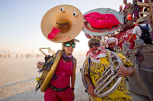 tuba players - burning man 2013, bunny ears, burning man, marching band, musicians, sousaphones, tuba players, tubas, woman