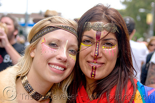 two women with tribal makeup and jewelry, andis, bay to breakers, costume, face painting, facepaint, festival, footrace, headdress, hippie, jewelry, makeup, necklace, street party, tribal, woman