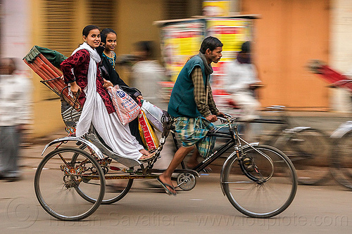 two young women on cycle rickshaw (india), bags, cycle rickshaw, man, moving, street, varanasi, women