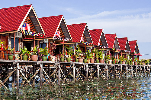uncle chan dive resort on mabul island (borneo), dive center, houses, pier, row