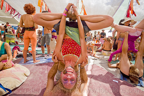 upside-down lotus - acroyoga - burning man 2012, acro-yoga, burning man, crowd, upside-down, woman