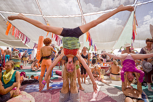 upside-down splits - acro-yoga - burning man 2012, acro-yoga, burning man, center camp, crowd, leg splits, spread, upside-down, woman