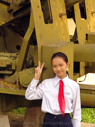 US artillery - war - vietnam, american, army, army museum, girl, hanoi, military, peace sign, people, red, red tie, v sign, vietnam war