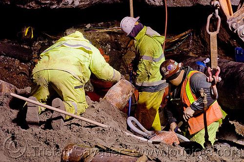 utility workers fixing broken water main (san francisco), awwa c515, construction workers, cut-off valves, gate valves, hetch hetchy water system, high-visibility vest, infrastructure, night, reflective vest, repairing, resilient, safety helmet, safety vest, sfpuc, sink hole, utility crew, utility workers, water department, water main, water pipe, working