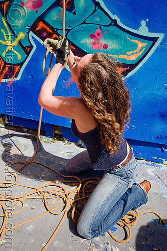 valerie pulling rope - graffiti wall, defenestration building, graffiti, rope access, ropework, valerie, woman