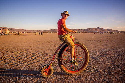 velocipede with off-road tires - burning man 2015, bicycle, bike, burning man, hat, people, riding, tires, velocipede