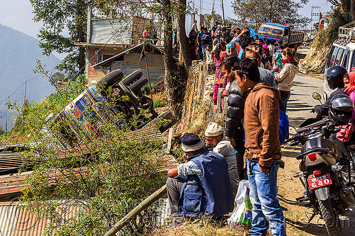 villagers looking at overturned truck in ditch (nepal), accident, crash, lorry, motorbike, motorcycle, mountain road, people, rollover, tata, tata motors, traffic accident, truck accident, up-side-down, wreck