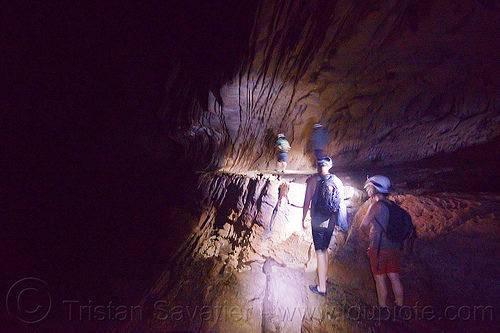 walking on a narrow ledge along clearwater river - caving in mulu (borneo), cavers, caving, clearwater cave system, clearwater connection, gunung mulu national park, natural cave, river cave, roland, spelunkers, spelunking, underground river